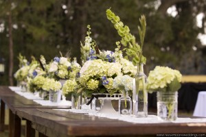 Low Table Arrangements in whites and greens with blush.
