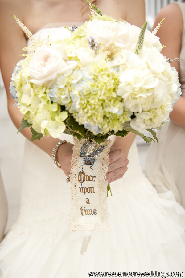 hand tied brides bouquet of hydrangea garden roses grasses and herbs